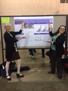 Dr. Kellyn Hall and Joyanna Struzzieri presenting their poster at ASHA.
