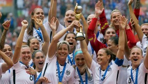 The United States Women's National Team celebrates with the trophy