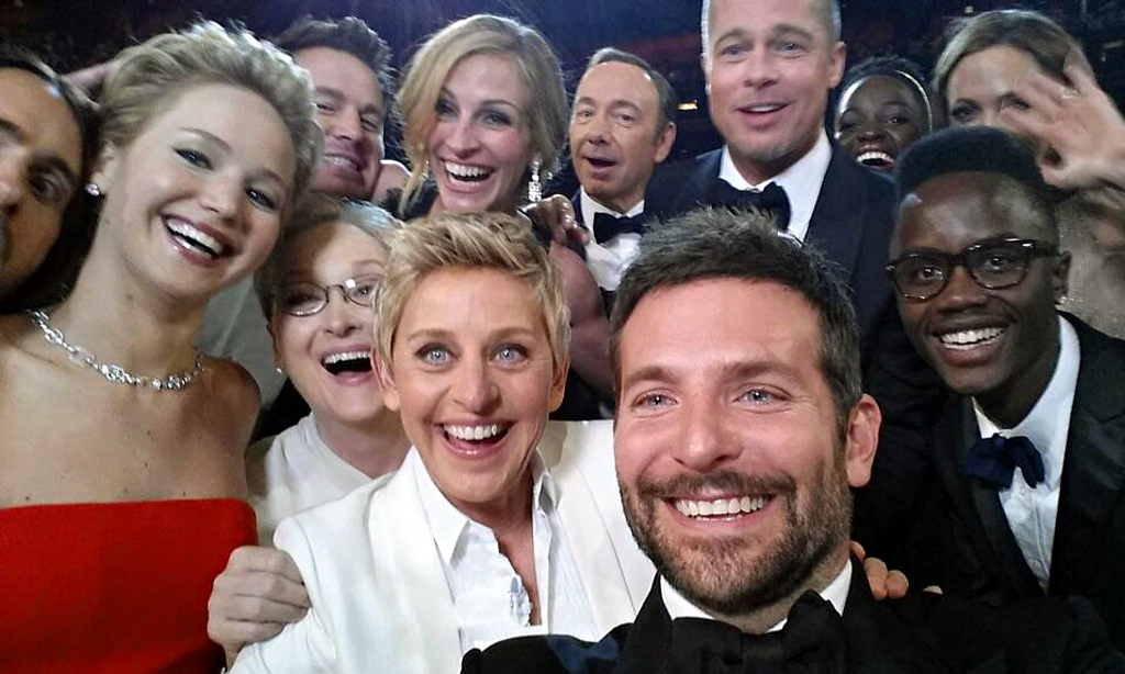 Ellen and Friends at the Oscars  Source: https://static-secure.guim.co.uk/sys-images/Guardian/Pix/pictures/2014/3/6/1394124478517/Ellen-Degeneres-selfie-at-011.jpg